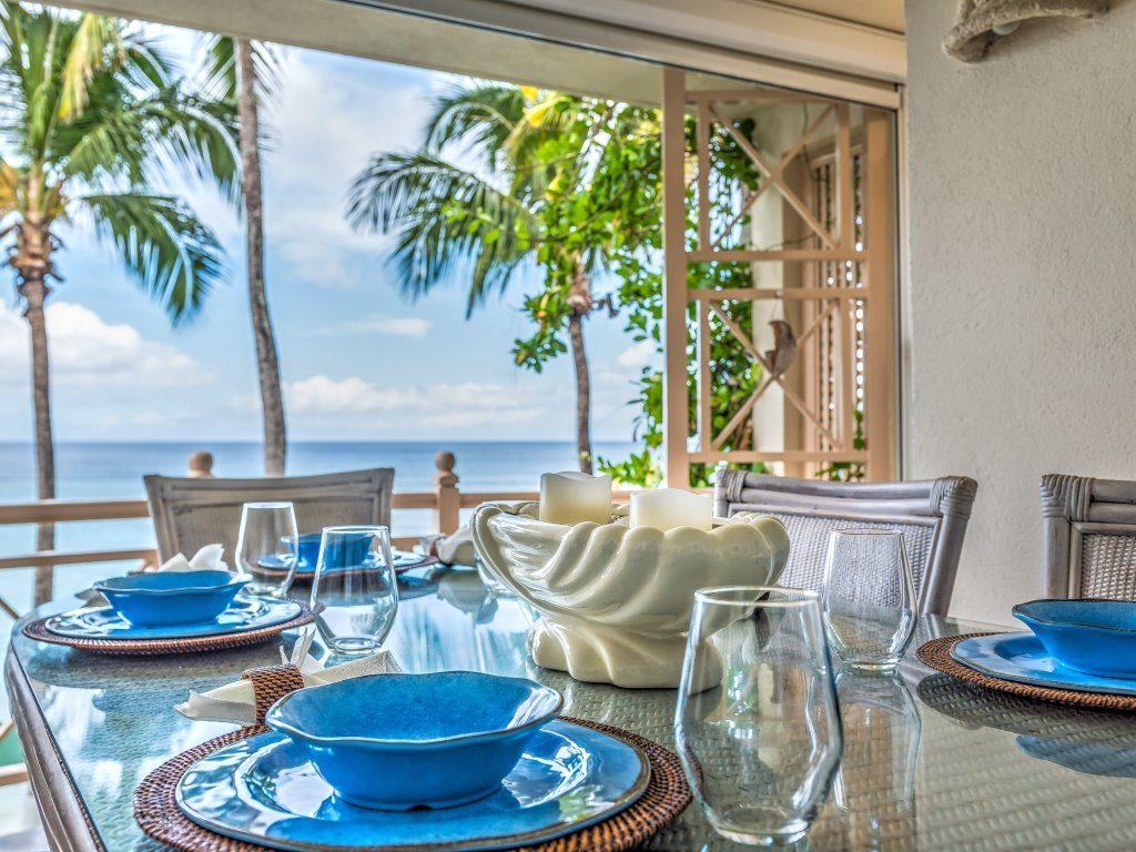 Blue bowls and plates on dining table by the sea