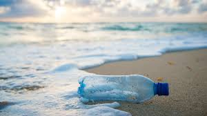 un happy Plastic bottle on an eco beach holiday